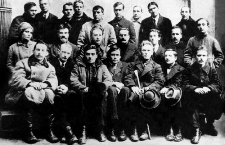 Image - Mykola Khvylovy (first row, third from left) among Ukrainian writers, painters, and composers (Kyiv, 1923).